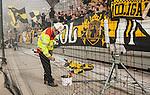 Solna 2014-08-13 Fotboll Allsvenskan AIK - Djurg&aring;rdens IF :  <br /> Brandpersonal personal p&aring; Friends Arena s&auml;tter ner bengaliska eldar i en hink nedanf&ouml;r AIK:s supportrar under matchen<br /> (Foto: Kenta J&ouml;nsson) Nyckelord:  AIK Gnaget Friends Arena Allsvenskan Derby Djurg&aring;rden DIF bengaler bengaliska eldar r&ouml;k tifo pyroteknik pyro brand eld