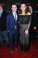 "30 March 2017 - Los Angeles, California - Dylan Minnette, Katherine Langford.  Premiere Of Netflix's ""13 Reasons Why"" held at Paramount Studios in Los Angeles. Photo Credit: Birdie Thompson/AdMedia"