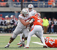 Ohio State Buckeyes offensive linesman Andrew Norwell (78) blocks Illinois Fighting Illini defensive back V'Angelo Bentley (2) in front of Ohio State Buckeyes quarterback Braxton Miller (5) during the NCAA football game at Illinois on Saturday, November 16, 2013. (Columbus Dispatch photo by Chris Russell)