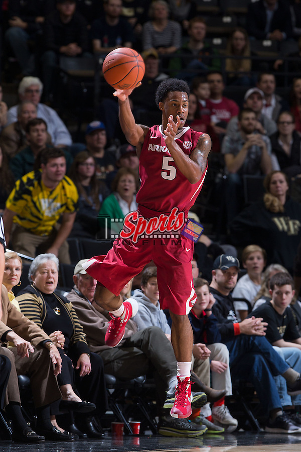 Anthlon Bell (5) of the Arkansas Razorbacks keeps the ball from going out of bounds during second half action against the Wake Forest Demon Deacons at the LJVM Coliseum on December 4, 2015 in Winston-Salem, North Carolina.  The Demon Deacons defeated the Razorbacks 88-85.  (Brian Westerholt/Sports On Film)