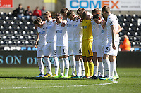 The Swansea team huddle together in memory of those lost during the Westminster attacks prior to kick off of the Premier League International Cup Semi Final match between Swansea City and Porto at The Liberty Stadium, Swansea, Wales, UK. Saturday, 25 March 2017Athena Pictures)