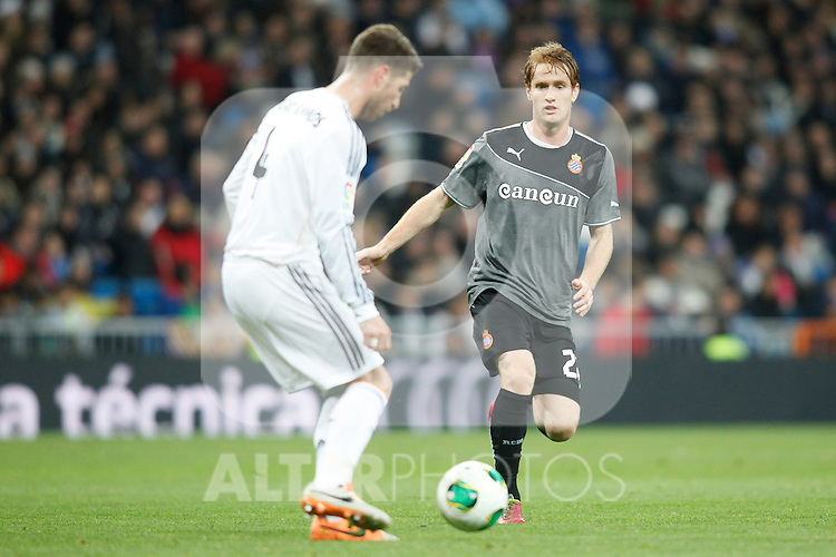 Real Madrid´s Sergio Ramos (L) and Espanyol´s Alex during Spanish Copa del Rey (King's Cup) quarterfinal second-leg football match in Santiago Bernabeu stadium in Madrid, Spain. January 28, 2014. (ALTERPHOTOS/Victor Blanco)