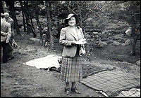BNPS.co.uk (01202 558833)Pic:    Rowley's/BNPS<br /> <br /> A 1950's picnic on the Balmoral estate - The Queen Mother, posing in a tartan skirt, with a corgi behind her.<br /> <br /> Two previously unknown poems by celebrated writer Daphne du Maurier have been discovered hidden inside a photograph frame.<br /> <br /> They are believed to have been penned in the late 1920s, when she was in her early 20s and an unknown in the literary world.<br /> <br /> The poems were written on a carefully folded sheet of A4 paper concealed within a 5ins high blue leather frame which contained a photo of du Maurier in a swimming costume. <br /> <br /> They were uncovered by an eagle-eyed auctioneer who has been tasked with selling an archive of du Maurier's letters and photos, which includes snaps with the Royals.