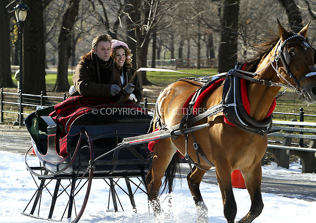 Sarah Jessica Parker and Mikhail Baryshnikov film a snow scene for Sex and the City on a freezing day in Central Park, New York City. December 03 2003. Please byline: NY Photo Press.   ..*PAY-PER-USE*      ....NY Photo Press:  ..phone (646) 267-6913;   ..e-mail: info@nyphotopress.com