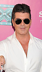 HOLLYWOOD, CA - SEPTEMBER 11: Simon Cowell arrives at the 'The X Factor' Season 2 Premiere Party at Grauman's Chinese Theatre on September 11, 2012 in Hollywood, California.