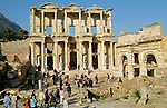 EPHESUS, TURKEY - NOVEMBER 25: Tourists visit the ruins of the Celsus Library in the ancient Turkish city of Ephesus on November 25, 2007.