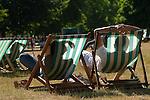 Heat wave hot weather couple deckchairs Hyde Park London Uk 2010