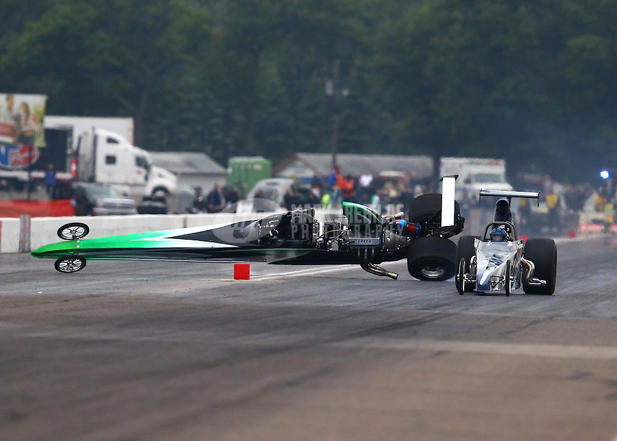 Aug 17, 2014; Brainerd, MN, USA; NHRA top dragster driver Monte Green (left) crashes alongside Don Kritzky during the semi finals of the Lucas Oil Nationals at Brainerd International Raceway. Mandatory Credit: Mark J. Rebilas-USA TODAY Sports