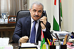 Palestinian Prime Minister Mohammad Ishtayeh, makes a phone call to Prime Minister of Greece, in the West Bank city of Ramallah, on June 18, 2020. Photo by Prime Minister Office