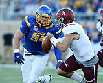 BROOKINGS, SD - OCTOBER 7: Kellen Soulek #94 from South Dakota State University closes in on Sam Straub #4 from Southern Illinois in the first half of their game Saturday night at Dana J. Dykhouse Stadium in Brookings. (Photo by Dave Eggen/Inertia)