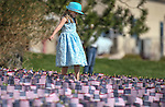 Jaelynn Smith, 6, walks through some of the nearly 8,000 American flags planted in the lawn of Western Nevada College in Carson City, Nev., on Friday, May 1, 2015. The WNC Veterans Resource Center is holding a Veterans Suicide Walk Saturday, May 2 starting at 10 a.m. at Bully's Sports Bar and Grill to help raise awareness of the 8,030 veteran suicides each year. <br /> Photo by Cathleen Allison/Nevada Photo Source