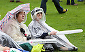 People brave the rain at Belfast Botanic Gardens, where the Big IF Belfast concert is taking place ahead of the G8 Summit in Northern Ireland, Saturday, June 15, 2013. Photo/Paul McErlane