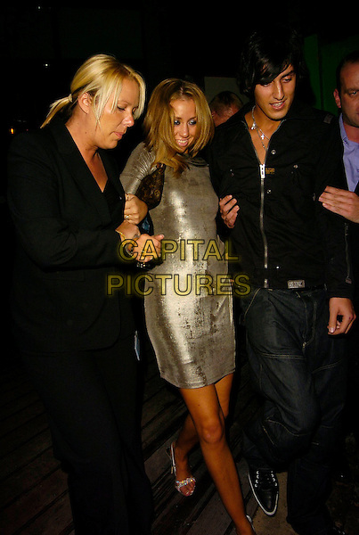 GRACE ADAMS-SHORT & MIKEY DALTON.The BB7 wrap party, Gilgamesh restaurant, London, UK..August 21st, 2006.Ref: CAN.Big Brother full length minder Adams Short silver dress jeans denim black jacket holding hands.www.capitalpictures.com.sales@capitalpictures.com.©Can Nguyen/Capital Pictures