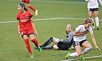 Portland, Oregon - Saturday May 21, 2016: The Portland Thorn's Nadia Nadim (9) and  Washington Spirit's Stephanie Labbé (1) and Alyssa Kleiner (22) during a regular season NWSL match at Providence Park.