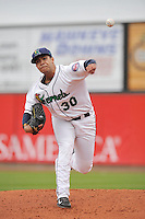 Josue Montanez #30 of the Cedar Rapids Kernels warms up in the bullpen prior to the game against the Kane County Cougars at Perfect Game Field on May 1, 2014 in Cedar Rapids, Iowa. The Kernels won 5-2.   (Dennis Hubbard/Four Seam Images)