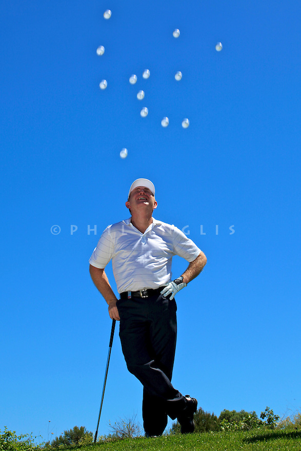 Tony Johnstone of Zimbabwe watches a deluge of golf balls !!/ Mallorca Open Senior 11-13 May 2012. (Picture Credit / Phil Inglis)