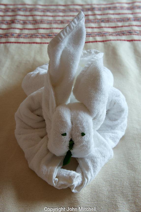 Rabbit towel origami in a guest room at the Hotel Hacienda Uxmal near the Mayan ruins of Uxmal, Yucatan, Mexico..        .