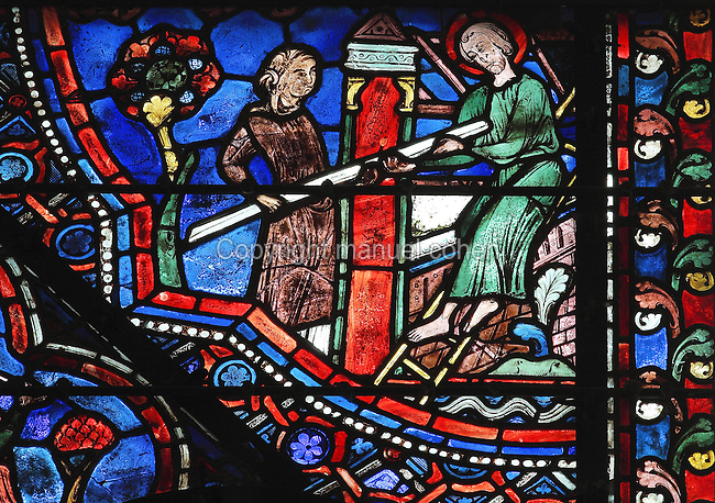 Having crossed the river, Julian and his wife settle on the banks to help any travellers in distress. They build a hospital and hostelry which will welcome all strangers. Julian is up a ladder taking a wooden beam from his wife to construct the building. Section of Julian and his wife building a hostelry on the banks of a river, 1215-25, from the Life of St Julian the Hospitaller window in the chapel of St Julian in the ambulatory of Chartres Cathedral, Eure-et-Loir, France. Chartres cathedral was built 1194-1250 and is a fine example of Gothic architecture. Most of its windows date from 1205-40 although a few earlier 12th century examples are also intact. It was declared a UNESCO World Heritage Site in 1979. Picture by Manuel Cohen