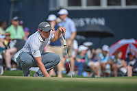 Paul Dunne (IRE) lines up his putt on 18 during round 4 of the Houston Open, Golf Club of Houston, Houston, Texas. 4/1/2018.<br /> Picture: Golffile | Ken Murray<br /> <br /> <br /> All photo usage must carry mandatory copyright credit (&copy; Golffile | Ken Murray)
