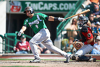 Dayton Dragons catcher Yovan Gonzalez #4 bats in front of catcher Austin Hedges during a Midwest League game against the Fort Wayne TinCaps at Parkview Field on August 19, 2012 in Fort Wayne, Indiana.  Dayton defeated Fort Wayne 5-1.  (Mike Janes/Four Seam Images)