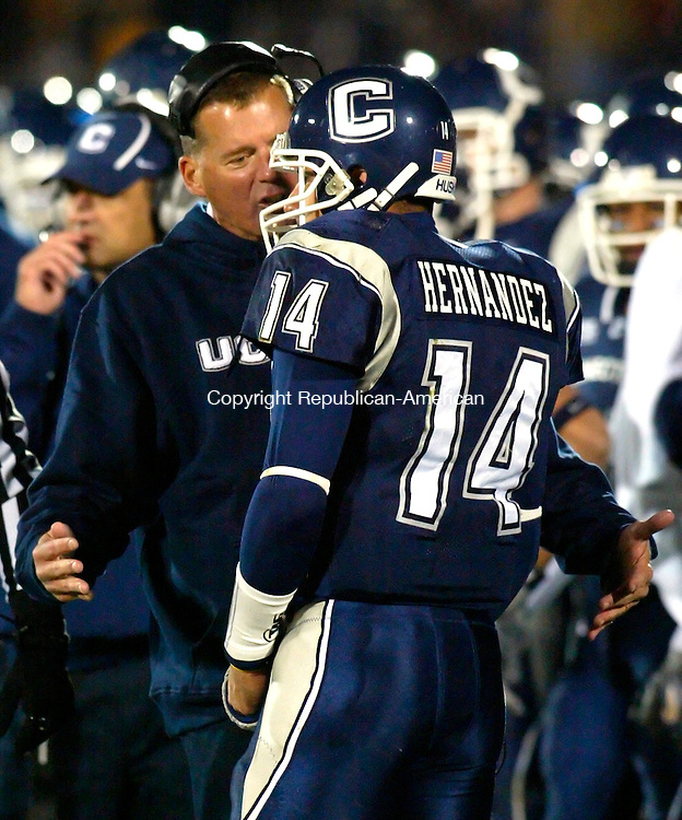 EAST HARTFORD, CT--20 OCTOBER 2006--102006JS10-UConn's Head Coach Randy Edsall gives an earfull to quarterback D.J. Hernandez after he tossed an interception insead of taking a sack during their 37-11 loss to West Virginia Friday at Rentschler Field in East Hartford.<br /> Jim Shannon / Republican-American