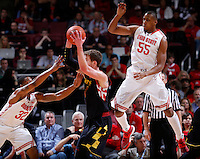 Ohio State Buckeyes guard Lenzelle Smith Jr. (32) and Ohio State Buckeyes center Trey McDonald (55) try to overwhelm Maryland Terrapins forward Evan Smotrycz (1) in the first half of the college basketball game between the Ohio State Buckeyes and the Maryland Terrapins at the Jerome Schottenstein Center in Columbus, Wednesday evening, December 4, 2013. As of half time the Ohio State Buckeyes led the Maryland Terrapins 43 - 26. (The Columbus Dispatch / Eamon Queeney)
