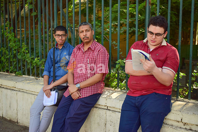 Egyptian students stand outside their school in the first day of high school exams, in Cairo, Egypt, on June 04, 2017. Photo by Amr Sayed
