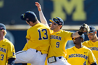 Michigan Wolverines shortstop Michael Brdar (9) celebrates defeating the Illinois Fighting Illini with teammate Keith Lehmann (13) in an NCAA baseball game on April 8, 2017 at Ray Fisher Stadium in Ann Arbor, Michigan. Michigan defeated Illinois 7-0. (Andrew Woolley/Four Seam Images)