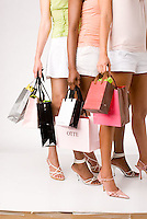 Group of women standing holding shopping bags<br />