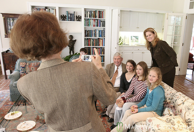 Former Florida first lady Adel Graham, left, takes a photo of her husband, former Florida Governor Bob Graham, seated left, his daughter Suzanne Gibson, standing, and her daughters, from left, Kendall, Ausley, and Adel, all 11 years-old, in the Florida Room of the Governor's Mansion to show the grandchildren where the former first family used to live in Tallahassee  February 20, 2007.    (Mark Wallheiser/TallahasseeStock.com)