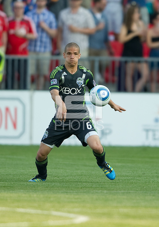 Seattle Sounders FC midfielder Osvaldo Alonso #6 in action during an MLS game between the Seattle Sounders FC and the Toronto FC at BMO Field in Toronto on June 18, 2011..The Seattle Sounders FC won 1-0.