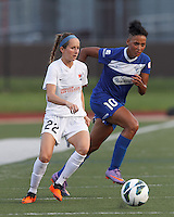 Sky Blue FC midfielder Manya Makoski (22) passes back to goalkeeper and Boston Breakers forward Lianne Sanderson (10) responds. In a National Women's Soccer League (NWSL) match, Boston Breakers (blue) defeated Sky Blue FC (white), 3-2, at Dilboy Stadium on June 30, 2013.