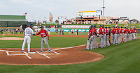 Round Rock Express manager Steve Buechele #22 shakes hand with Oklahoma City Redhawks interim manager Tom Lawless #12 before the Pacific Coast League baseball game against the  on April 3, 2014 at the Dell Diamond in Round Rock, Texas. The Redhawks defeated the Express 7-6 in the season opener for both teams. (Andrew Woolley/Four Seam Images)