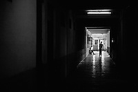 Two patients are seen in a corridor at the Rajan Babu TB hospital in New Delhi, India.