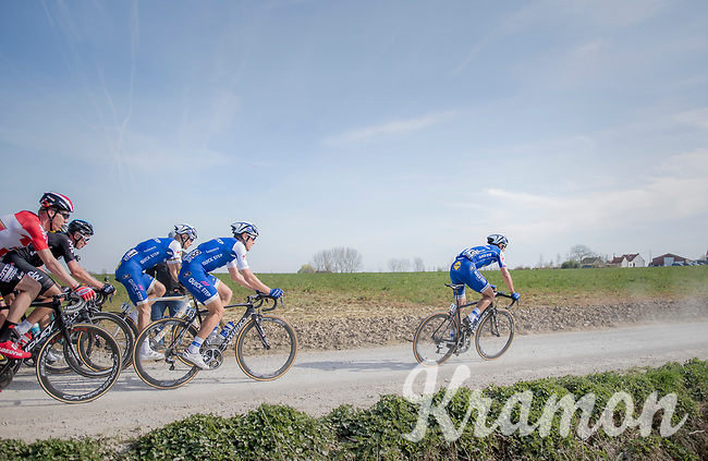 peloton led by Zdenek Stybar (CZE/Quick Step Floors) racing over the newly added gravel roads around Ploegsteert, called 'Plugstreets'<br /> <br /> 79th Gent-Wevelgem 2017 (1.UWT)<br /> 1day race: Deinze &rsaquo; Wevelgem - BEL (249km)