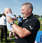 Rangers army visit in Germany - Ally McCoist with 4 month old baby Tory Vernon-Hicks at the team hotel in Marienfield, Germany