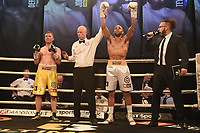 Grant Dennis (white shorts) defeats Joe Hurn during Ultimate Boxxer III at Indigo at the O2 London on 10th May 2019