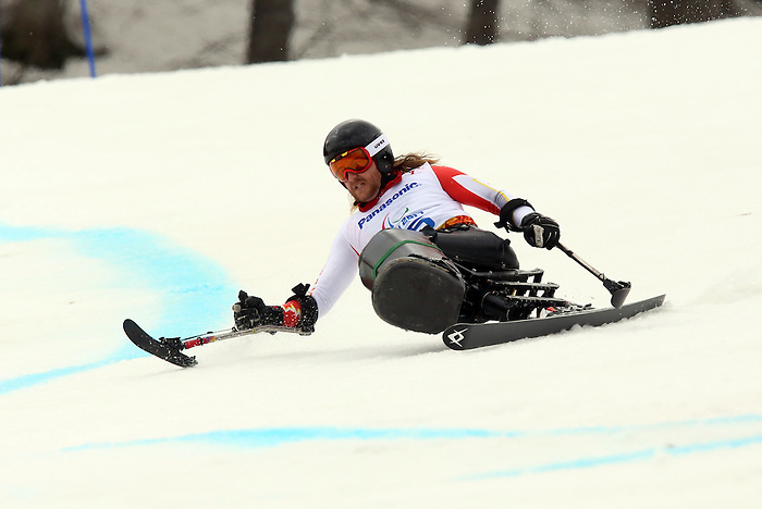 Sochi, Russia,09/03/2014. Canadian Caleb Brousseau competes in the men's Super G, sitting skiing at the 2014 Paralympic Winter Games in Sochi, Russia. Brousseau won bronze in the event.(Photo:Scott Grant/Canadian Paralympic Committee)