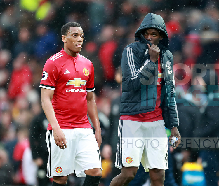 Anthony Martial of Manchester United and Paul Pogba of Manchester United walk off together during the premier league match at the Old Trafford Stadium, Manchester. Picture date 15th April 2018. Picture credit should read: Simon Bellis/Sportimage
