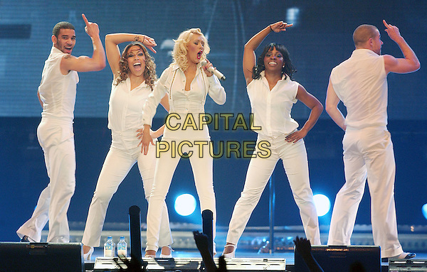 """CHRISTINA AGUILERA.Performs on her """"Back To Basics Tour"""" held at the Quicken Loans Arena, Cleveland, Ohio, USA..April 12th, 2007.stage concert live gig performance music full length white trousers high waist back up dancers singing suspenders braces singing shirt .CAP/ADM/DS.©Devin Simmons/AdMedia/Capital Pictures"""