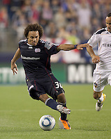 New England Revolution defender Kevin Alston (30) dribbles. In a Major League Soccer (MLS) match, the Los Angeles Galaxy defeated the New England Revolution, 1-0, at Gillette Stadium on May 28, 2011.
