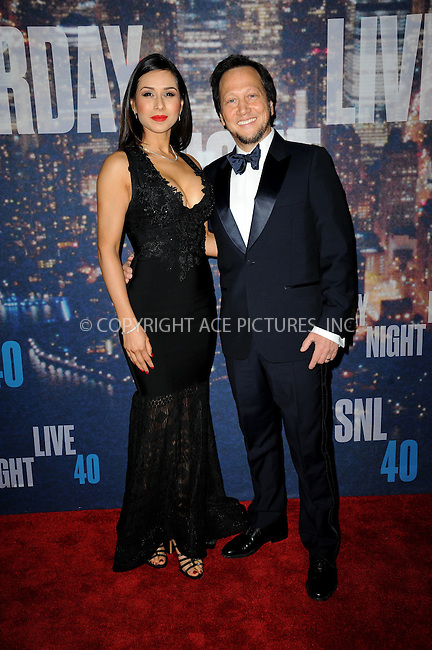WWW.ACEPIXS.COM<br /> February 15, 2015 New York City<br /> <br /> Patricia Azarcoya Schneider (L) and Rob Schneider walking the red carpet at the SNL 40th Anniversary Special at 30 Rockefeller Plaza on February 15, 2015 in New York City.<br /> <br /> Please byline: Kristin Callahan/AcePictures<br /> <br /> ACEPIXS.COM<br /> <br /> Tel: (646) 769 0430<br /> e-mail: info@acepixs.com<br /> web: http://www.acepixs.com