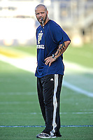 30 March 2012:  FIU Strength and Conditioning Coach Chad Smith puts players through drills prior to the FIU Football Spring Game at University Park Stadium in Miami, Florida.