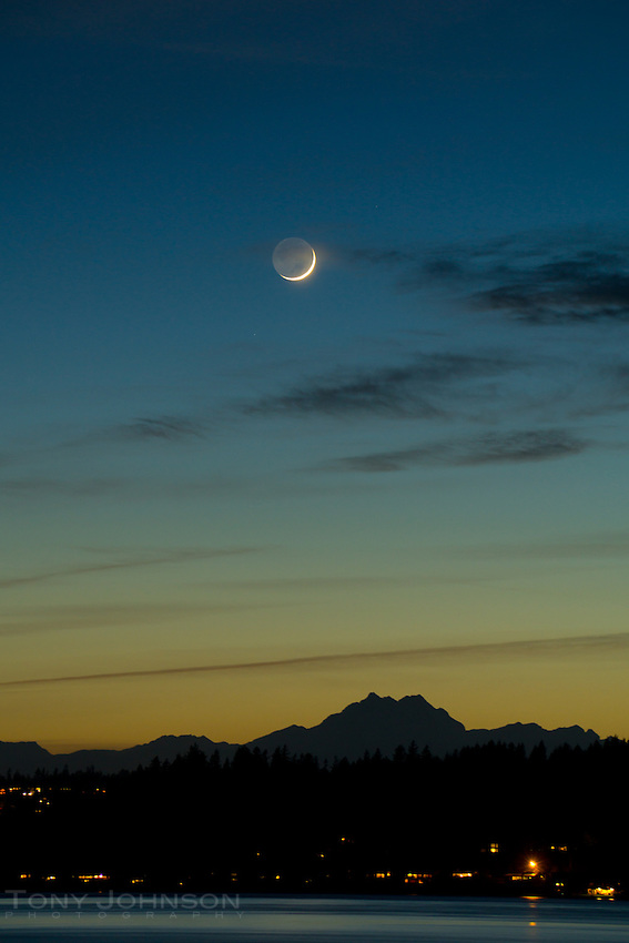 Sliver of a crescent moon over the Olympic Mountains as seen from Fort Ward, Bainbridge Island