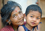Hari Maya Bhujel hugs her grandson, 5-year old Utsab, in Majhitar, a village in the Dhading District of Nepal.<br /> <br /> Parental consent obtained.