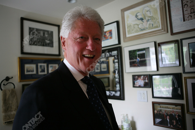 Former US President Bill Clinton shows his 'barn' office, next to his home, where he wrote his autobiography, Chappaqua, New York, USA, May 15, 2008