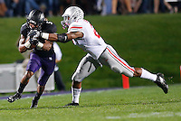 Northwestern Wildcats running back Venric Mark (5) is tackled by Ohio State Buckeyes linebacker Ryan Shazier (2) during Saturday's NCAA Division I football game at Ryan Field in Evanston on October 5 2013. (Barbara J. Perenic/The Columbus Dispatch)