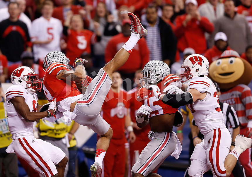 Ohio State Buckeyes wide receiver Devin Smith (9) hauls in a 39-yard touchdown pass from Ohio State Buckeyes quarterback Cardale Jones (12) in the first quarter of the Big Ten Championship game between the Ohio State Buckeyes and the Wisconsin Badgers at Lucas Oil Stadium in Indianapolis, Saturday night, December 6, 2014. (The Columbus Dispatch / Eamon Queeney)