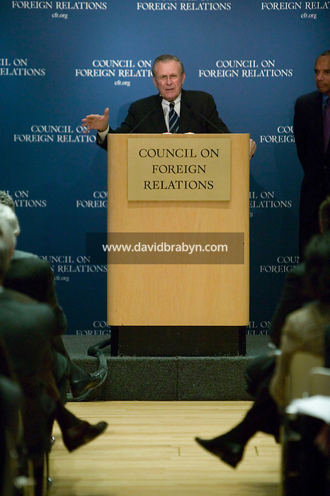 17 February 2006 - New York City, NY - Secretary of Defense Donald Rumsfeld answers questions from members of a think tank in New York City, USA, 17 February 2006, as session president and chairman of the American Express Company, Kenneth Chenault (R, background), looking on. Photo Credit: David Brabyn.