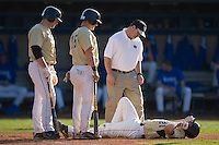 Wake Forest Demon Deacons trainer Jeff Strahm, Michael Murray #15 and Weldon Woodall #25 stand over Dustin Hood #21 after Hood was hit by a pitch at Jack Coombs Field March 29, 2009 in Durham, North Carolina. (Photo by Brian Westerholt / Four Seam Images)